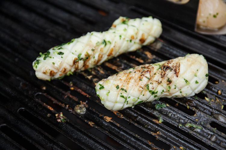 Gently allow the calamari to brown slightly on the outside. Cooking calamari in this manner on the grill will ensure the most tender calamari you will have ever had!