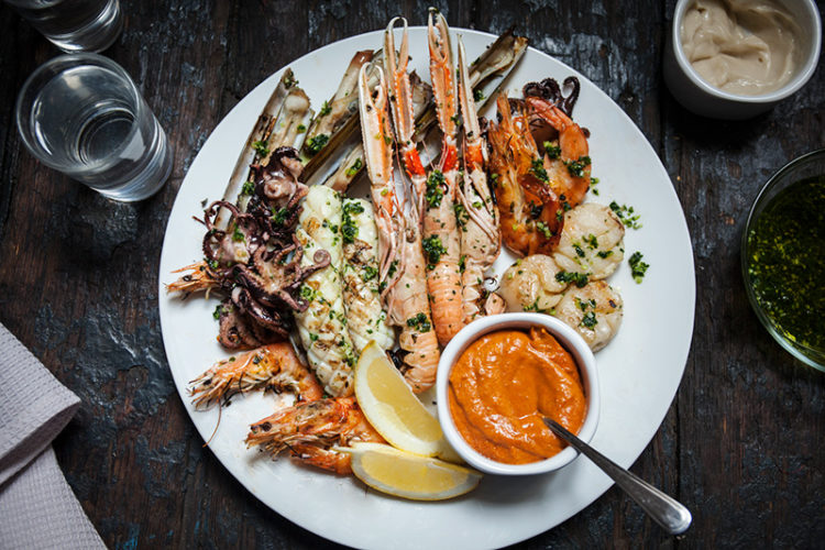 After your guests have plated-up, allow them to drizzle more of the flavoured oil over the seafood. Treat your guests to a delectable Spanish seafood feast, accompanied with fresh lemon wedges, garlicky Aioli and a brilliant almondy Romesco sauce!