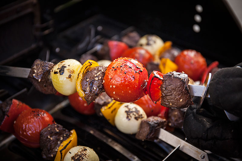 Using protective gloves, turn the skewers when one side has cooked through. Try not to turn the brochettes too often as this may dry out the meat and could cause the vegetables to break free from the skewer.